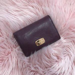 Michael Kors Plum wallet with gold details